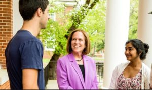 Guilford President Fernandes, center, with students.